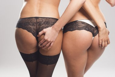 Two perfect female asses