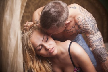 Sexy passionate young heterosexual couple on the bed
