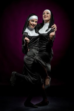 Two funny nuns indoors