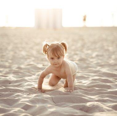 Adorable baby girl on the beach