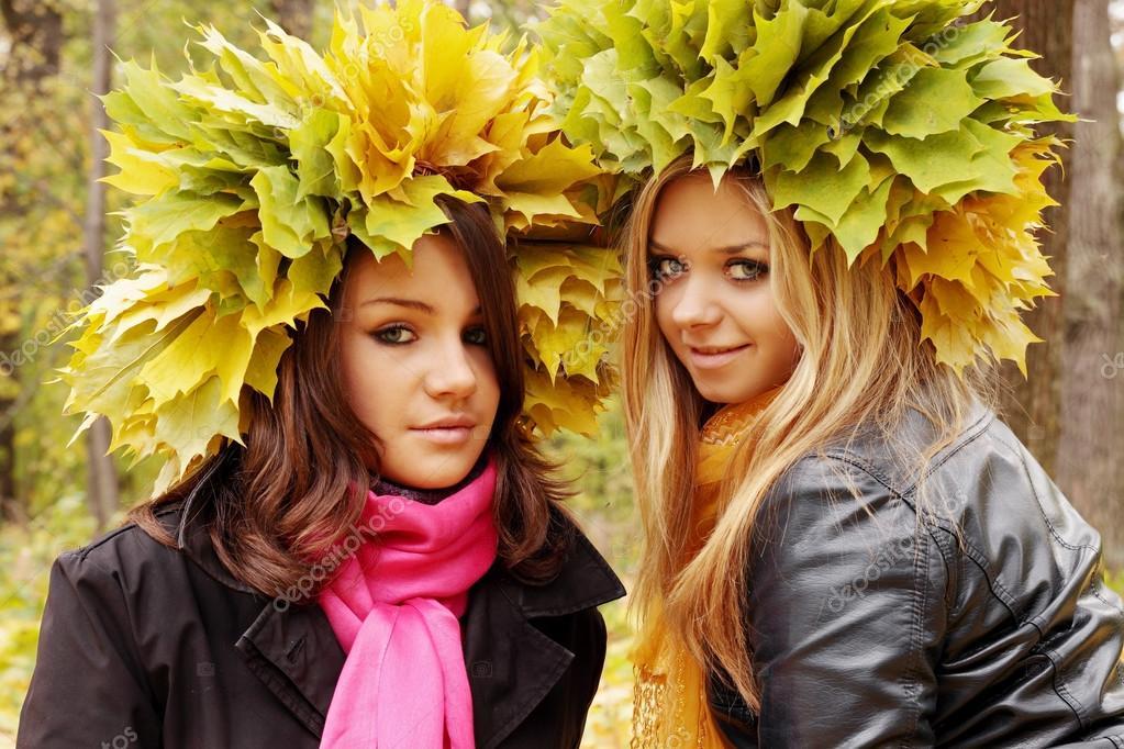 Two women wearing wreaths