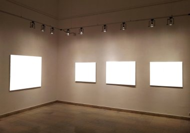 Empty frames on gallery wall