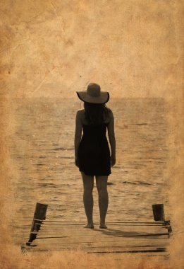 Vintage image of woman waiting on dock