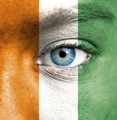 Fotografie Human face painted with flag of Ivory Coast