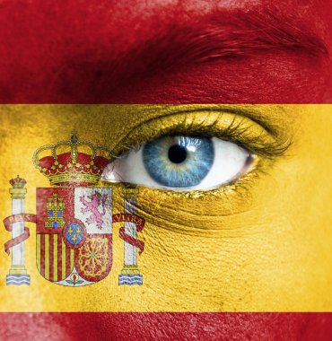 Human face painted with flag of Spain