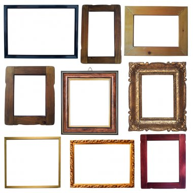 Collection of vintage wooden and golden empty frames isolated on
