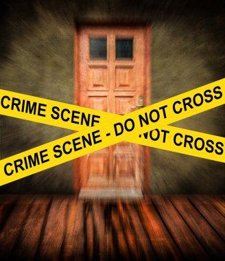 CRIME SCENE yellow tape against grunge room