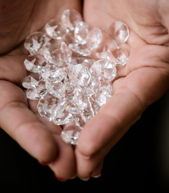 Pile of diamonds in woman hands