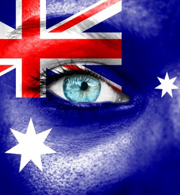 Woman face painted with flag of Australia