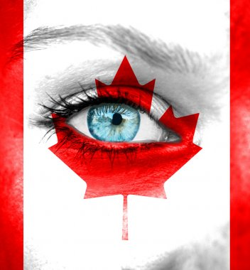 Woman face painted with flag of Canada