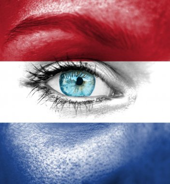 Woman face painted with flag of Netherlands