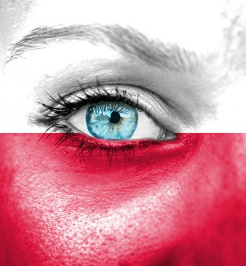 Woman face painted with flag of Poland