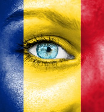 Woman face painted with flag of Romania