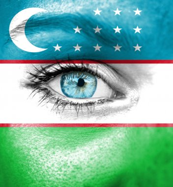 Woman face painted with flag of Uzbekistan