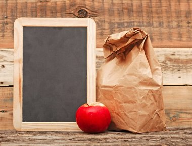school lunch over blank blackboard