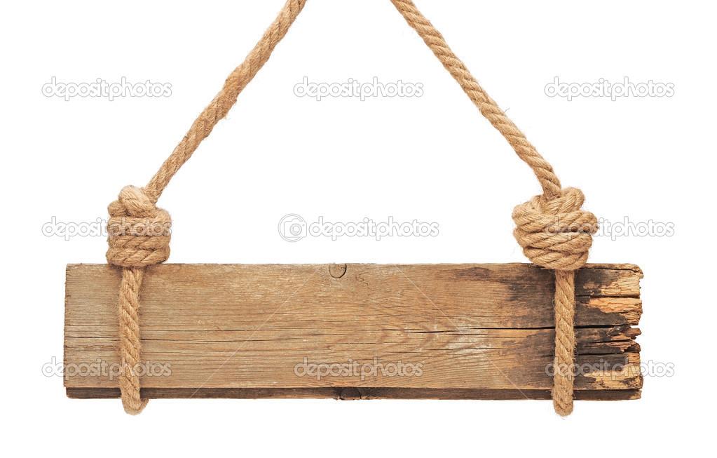 gros plan d 39 un panneau en bois vide suspendu une corde sur le dos blanc photographie. Black Bedroom Furniture Sets. Home Design Ideas