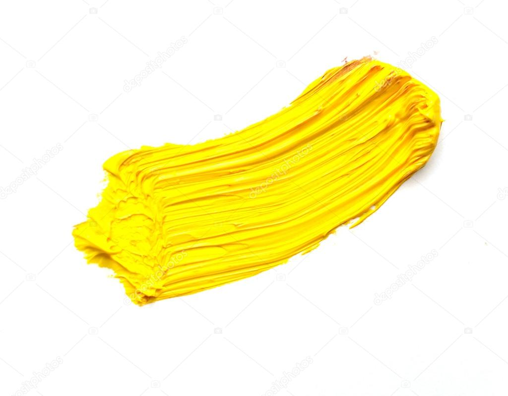 Yellow stroke of the paint brush isolated on white stock for White paint going yellow