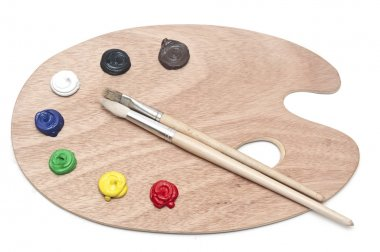 Photo of a wooden artists palette loaded with various colour pai