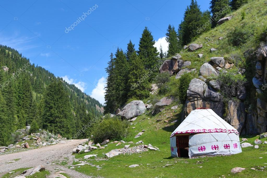 Yurta - habitation of nomads in picturesque mountains.