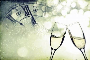 Glasses with champagne over holiday background
