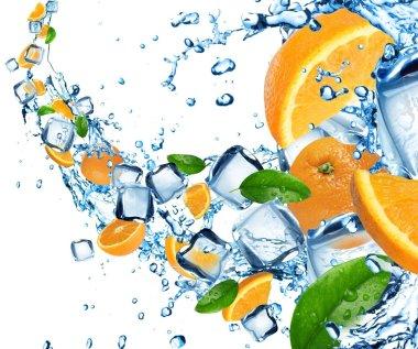 Oranges in water splash