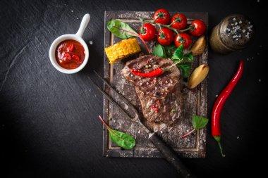 Beef steak on wooden table