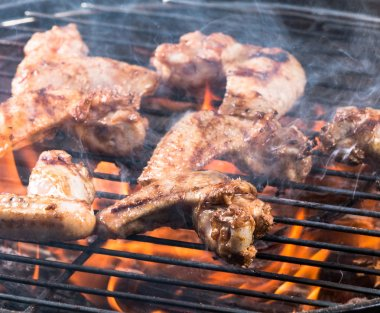 Grilled chicken wings on the grill.