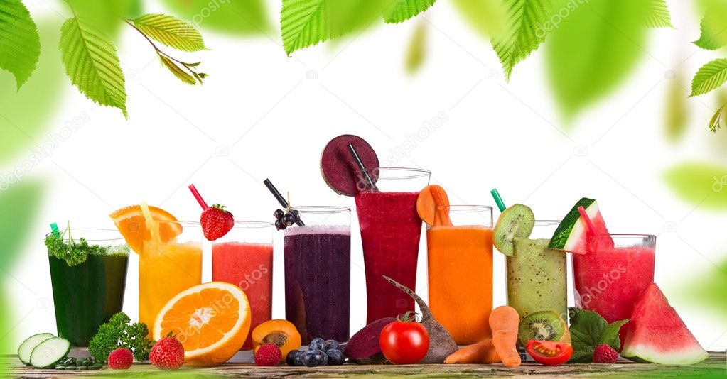 Fresh fruit juices on wooden table
