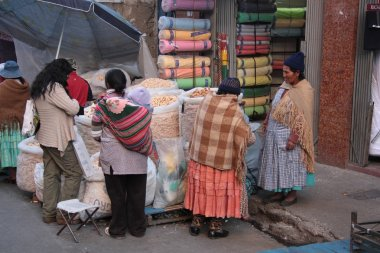 People buy food in a street of La Paz, Bolivia