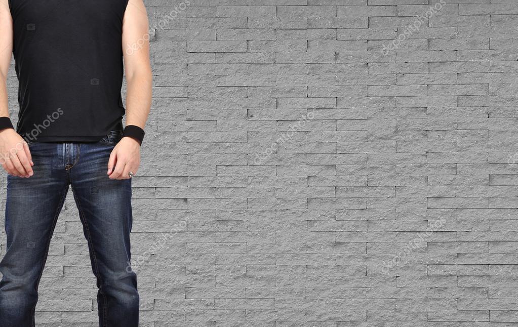 Rock star men standing on brick wall backgraund