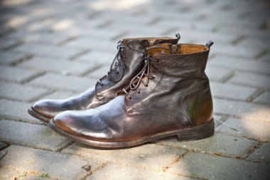 Leather shoes brown outdoors. Fashionable leather high boots. autumn - spring shoes