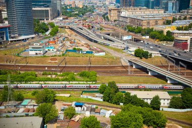 General view of the city, highway, railway.