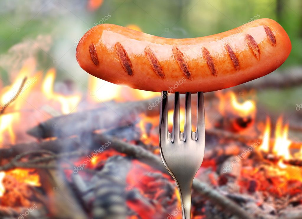 Sausage on a fork.