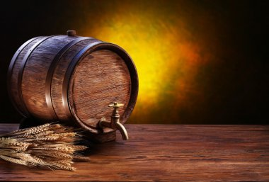 Old oak barrel on a wooden table. Behind blurred dark background. stock vector