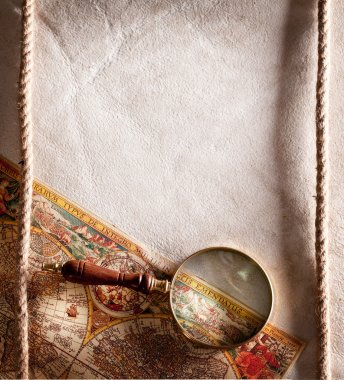 Magnifying glass on old parchment.