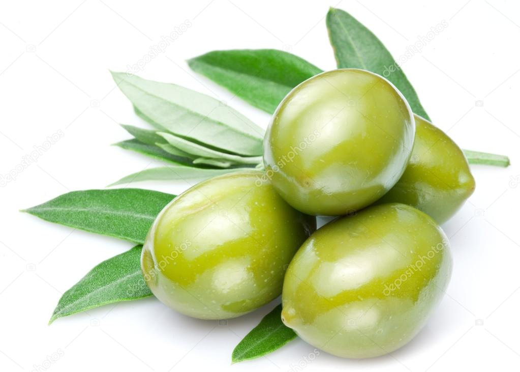 Green olives with leaves.