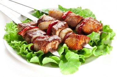 Grilled kebab (shashlik) on spits.