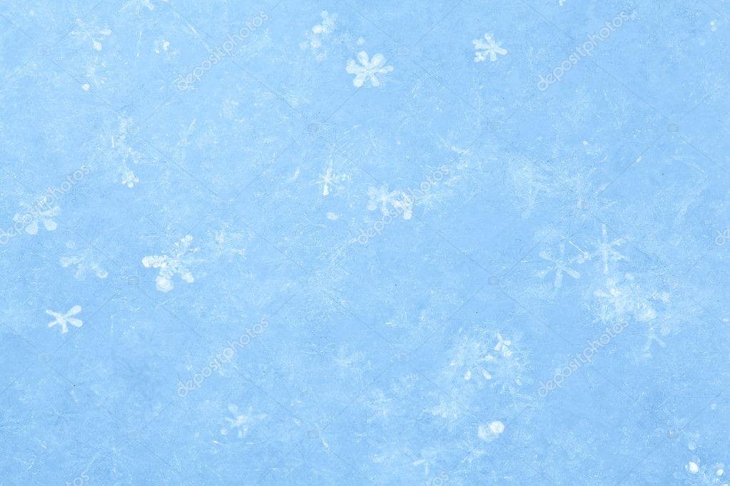 Blue sparkling snow background.
