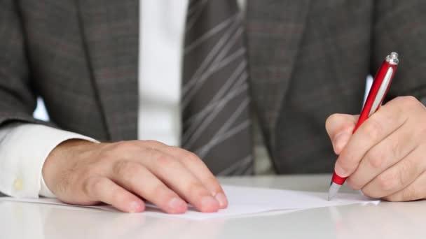 Businessman writing application form