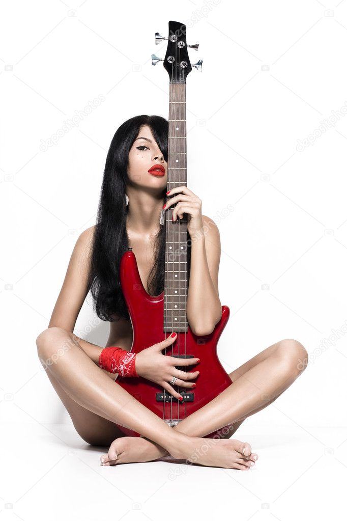 nude girl holding guitar