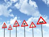 dopravní značky s mraky