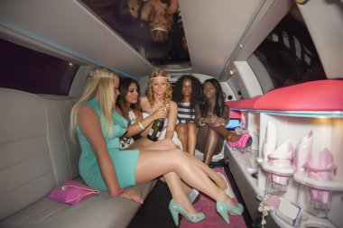 girls drink in limo