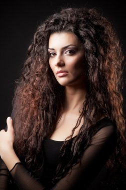 Portrait of glamour young girl with beautiful long curly hair