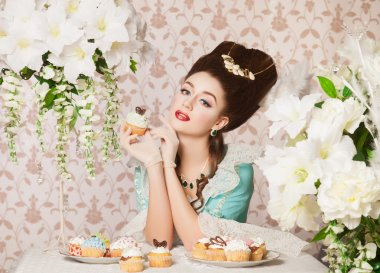 Old fashioned sexy woman with cupcake