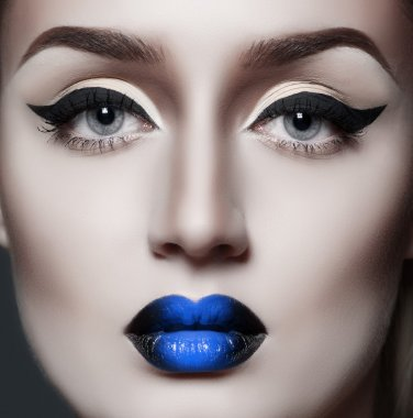 Fashion gothic woman with sexy blue lips
