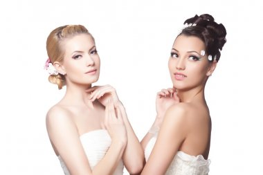 Two beautiful brides with fashion hairstyle and make-up