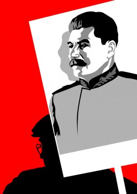 Man and portrait of Stalin
