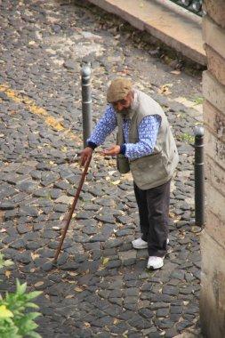 Begger oldster on street Lisbon (Portugal).