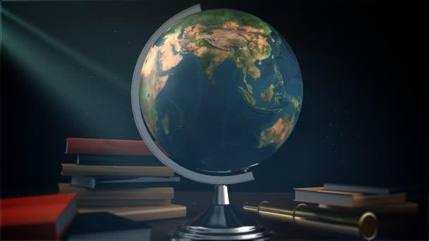 otáčející se zeměkouli s knihami