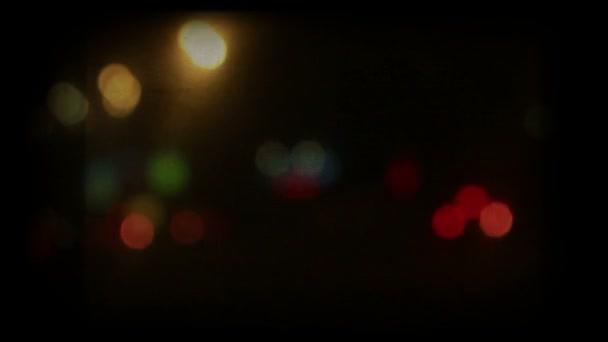 Car night lights defocused shot. Retro color styled film, 1080p.